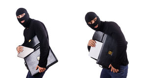 The industrial espionage concept with person in balaclava Stock Photo
