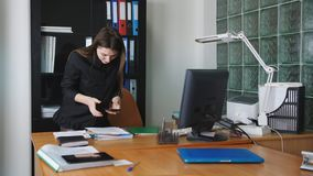 Industrial espionage. Woman spy on the phone taking pictures of secret files stock footage