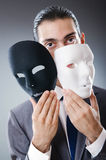 Industrial espionate concept - masked businessman. Industrial espionate concept with masked businessman Stock Image