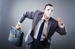 Industrial espionate concept - masked businessman. Industrial espionate concept with masked businessman Stock Photos
