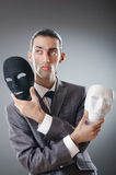 Industrial espionate concept - masked businessman Stock Photos