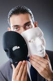 Industrial espionate concept - masked businessman Royalty Free Stock Photography
