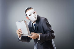 Industrial espionate concept - masked businessman Stock Photo