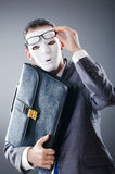 Industrial espionate concept - masked businessman Stock Images
