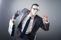 Industrial espionate concept - masked businessman Stock Images
