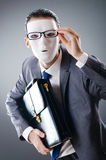 Industrial espionate concept - masked businessman Royalty Free Stock Images