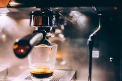 Professional espresso machine preparing fresh espresso in local pub, bistro or restaurant Royalty Free Stock Image