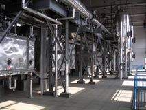 Industrial evaporator bank with shiny pipes and equipment.  Royalty Free Stock Photos