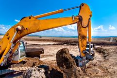 Industrial excavator bulldozer digging in sandpit Stock Photo