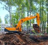 Industrial excavator, bulldozer or heavy machinery working Stock Photos