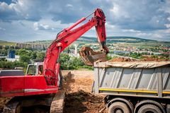 Industrial excavator loader with rised bucket Stock Photography