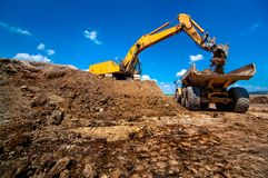 Industrial excavator loading soil material Royalty Free Stock Image