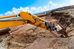 Industrial excavator moving earth Royalty Free Stock Images