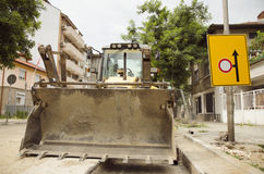 Industrial Excavator Next To A Warning Sign Stock Image