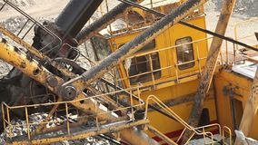Industrial excavator and working man in a quarry, a large jaded industrial excavator stock video