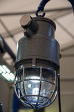 Industrial explosion-proof lantern shines with white light at co Royalty Free Stock Images