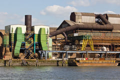 Industrial Facility. An industrial facility along the Maas river, just outside the Dutch city of Rotterdam.  Rotterdam is the second largest city and is home to Stock Image