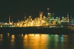 Industrial factories near a port at night Stock Photography