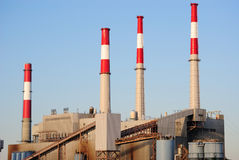Industrial Factory. An industrial factory with tall smoke staks Stock Image