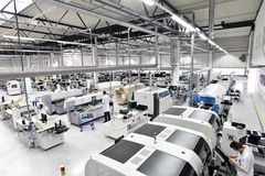 Industrial factory for assembly of microelectronics - interior a. Nd workers royalty free stock photography