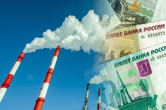 Industrial factory chimneys on background of money . Stock Images