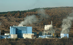 Industrial factory with chimneys and smoke Royalty Free Stock Images