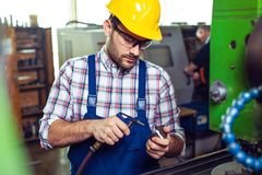 Industrial factory employee working in metal manufacturing industry. Industrial factory employee working in the metal manufacturing industry stock image
