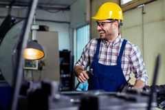 Industrial factory employee working in metal manufacturing industry. Industrial factory employee working in modern metal manufacturing industry royalty free stock photography