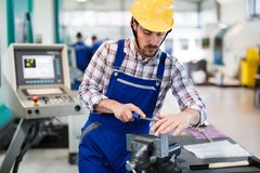 Industrial factory employee working in metal manufacturing industry. Industrial factory worker working in metal manufacturing industry stock images