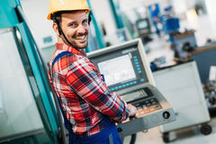 Industrial factory employee working in metal manufacturing industry stock photography