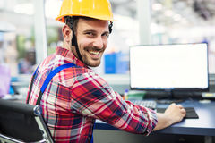 Industrial factory employee working in metal manufacturing industry. Industrial factory worker working in metal manufacturing industry royalty free stock images