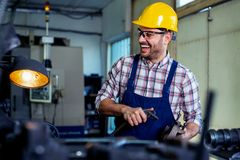 Industrial factory employee working in metal manufacturing industry. Industrial factory employee working in modern metal manufacturing industry royalty free stock image