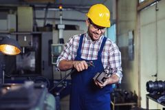 Industrial factory employee working in metal manufacturing industry. Industrial factory employee working in modern metal manufacturing industry royalty free stock photo
