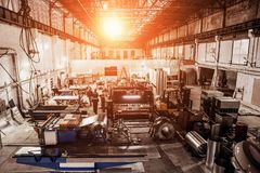 Industrial factory with equipment tools in large workshop or warehouse, industrial background. Industrial factory with equipment tools in large workshop or stock photography