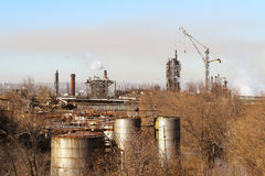 Industrial factory landscape with lots of details. Factory construction of housing and pipe on the background of distant industrial city Royalty Free Stock Photos