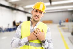 Industrial factory manager suffering chest heart pain stock photo