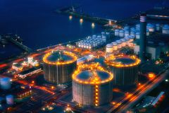 Industrial factory at night. With storage tanks stock photography