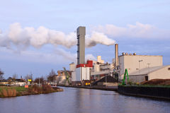 Industrial factory with smoking chimney Stock Photo