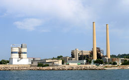 Industrial factory with tall chimney Stock Image