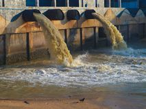 Industrial and factory waste water discharge pipe into the canal and sea and water pollution