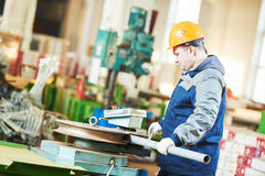 Industrial factory worker with tube bending machine Stock Images