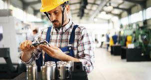 Industrial factory employee working in metal manufacturing industry royalty free stock photos