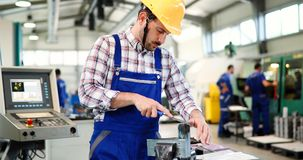 Industrial factory employee working in metal manufacturing industry. Industrial factory worker working in metal manufacturing industry royalty free stock photos