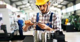 Industrial factory employee working in metal manufacturing industry. Industrial factory worker working in metal manufacturing industry royalty free stock photography