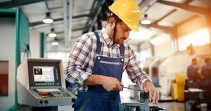 Industrial factory employee working in metal manufacturing industry. Industrial factory worker working in metal manufacturing industry royalty free stock photo
