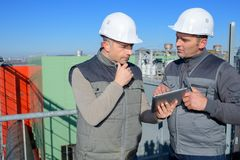 Industrial factory workers having conversation royalty free stock images