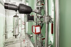 Industrial filtering equipment. Pipelines and stop valves in stainless steel. Stock Images