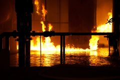 Industrial fire. Fire on water in industrial fire Royalty Free Stock Images
