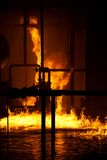Industrial fire. Fire on top of water Stock Photo