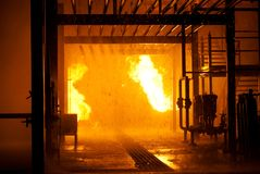 Industrial fire. From pipes with water falling Royalty Free Stock Images